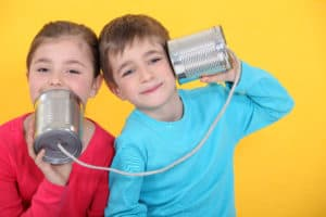 Kids Playing With Tin Can Telephones Auditory Learning