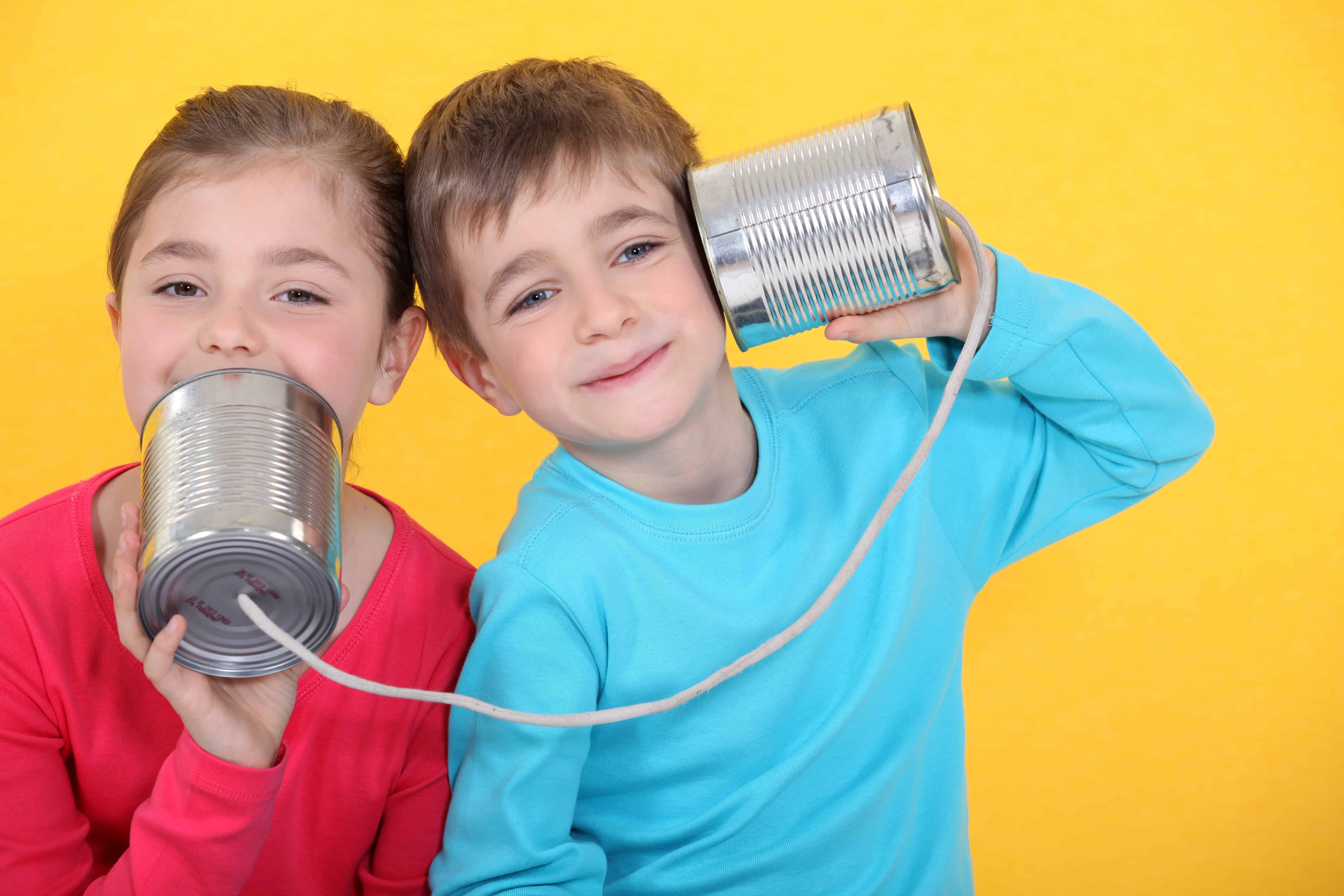 0c14da9e50 Kids having a phone call with tin cans on yellow background - Raise ...
